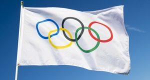 Что означает олимпийский флаг?